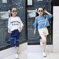 Chicas europeas Verano Caliente Del Hombro Agujero Suelta de Algodón T-shirt Ropa de Niños Azul Blanco