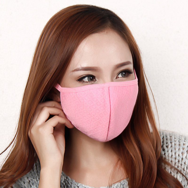 Girl wearing stylish pink mask.