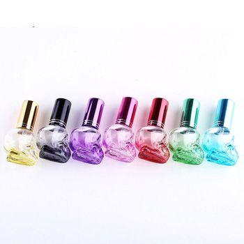 Mini frasco de Perfume portátil, 1 Uds./8 ml, forma de cráneo, reutilizable, frasco de Perfume vacío, contenedores de viaje, accesorios, 7 colores