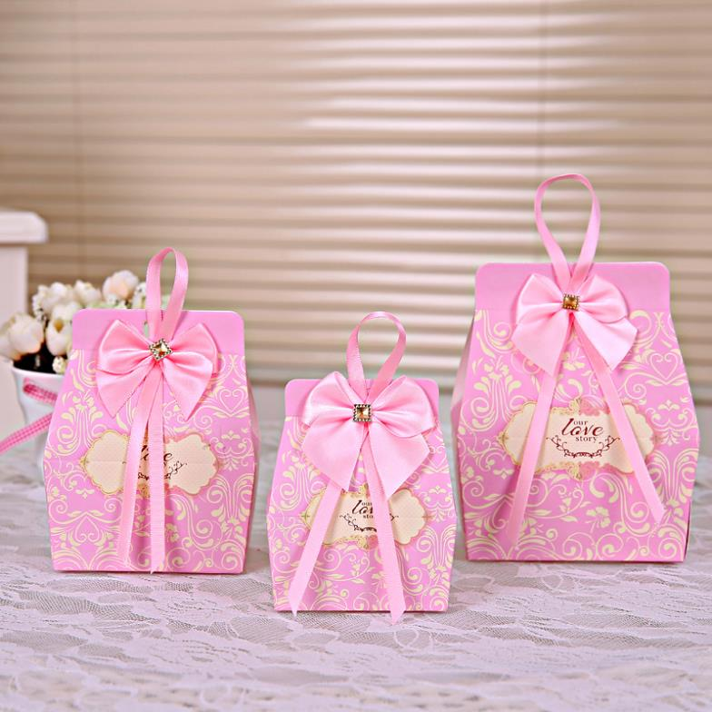 50pcs Pink Candy Boxes Party Favors Wedding Box Sweets Party Favour Baby  Shower Gift Bags w Ribbon Bow Decorations 8.5 5.5 5cm b5bf327fd