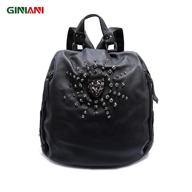 GINIANI Women's Solid Black Top Cow Leather Pocket Safe Backpack Unisex Tiger Head Surrounding Sun Shape Star Rivet Rucksack