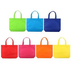 Image 2 - 10PC wielofunkcyjny prezent duże torba z rączkami dzieci Birthday Party favor włókniny torby na prezent 7 jednolity kolor z uchwytem torba na zakupy DIY prezent torba