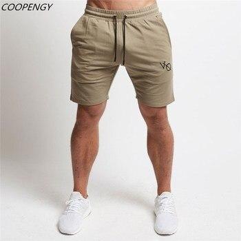 299b18bc61 2018New Moda hombre Pantalones cortos deportivos hasta la pantorrilla gyms  Fitness Bodybuilding Casual Joggers entrenamiento marca deportiva pantalones  ...