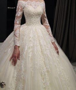Image 1 - יפה תחרה חתונה שמלות Seuqins אפליקציות כדור שמלה כבוי כתף אשליה ארוך שרוול כלה שמלות 2019