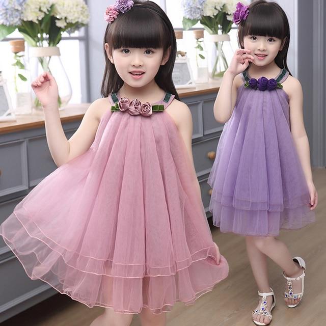Flor vestido de la muchacha para el partido y la boda del niño del ...