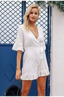 BerryGo Sexy deep v neck jumpsuit romper women Ruffled hollow out embroidery cotton white playsuit Elegant sashes jumpsuit short