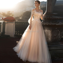 Amazing Champagne A Line Wedding Dresses with Long Puff Sleeves Sheer Scoop Lace Appliques Lace Up Buttons Bridal Gowns 2021