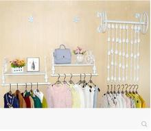 European iron art clothing rack shows the wall side hang frame on of womens wear
