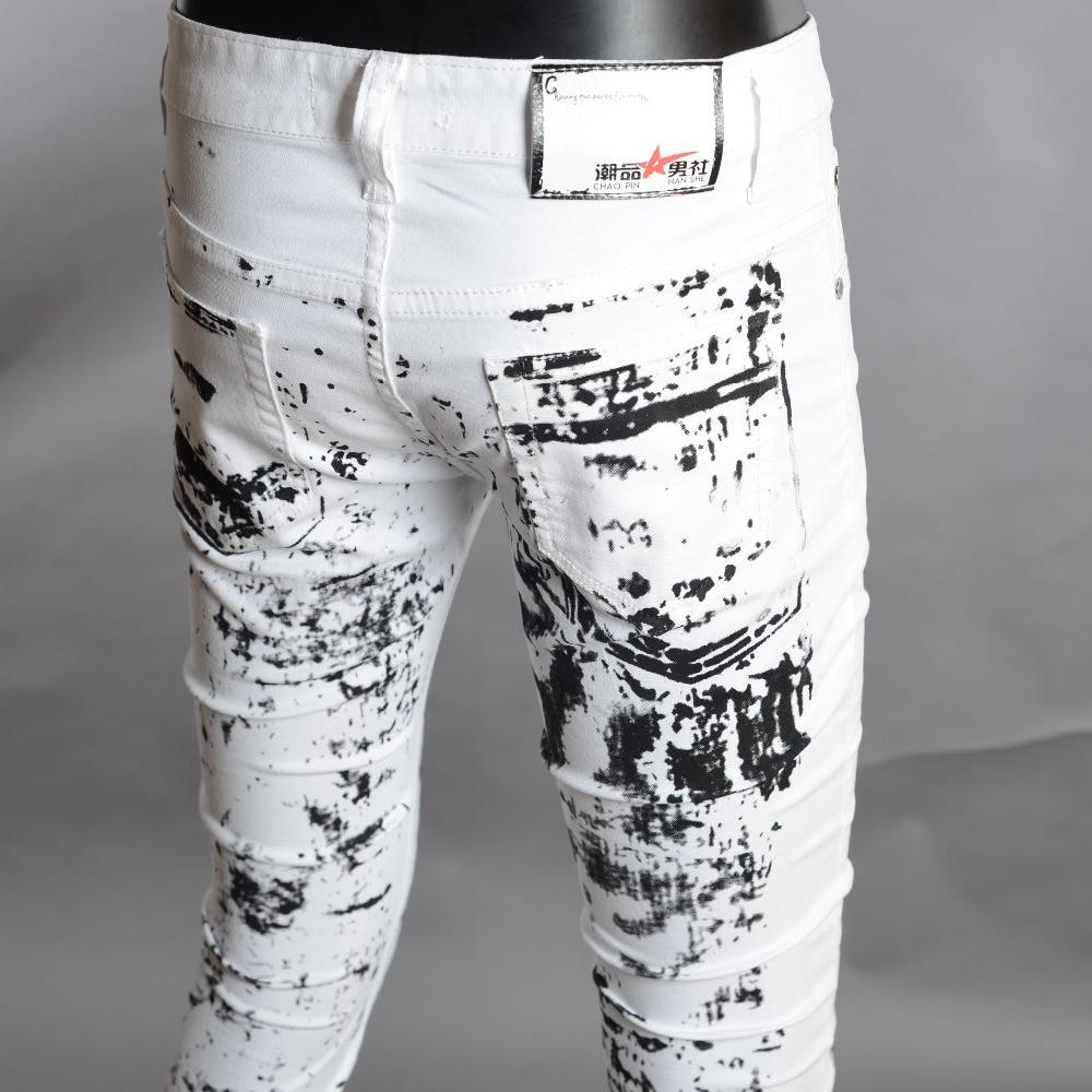new ink splashes printing male jeans men Korean men Slim white casual personality skull flower pants free shipping vaqueros