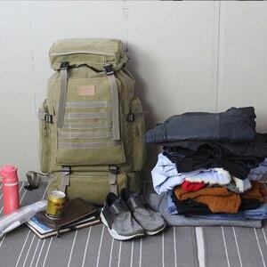 Image 4 - 60L大型軍用バッグキャンバスバックパック戦術的なバッグキャンプハイキングリュックサック軍mochilaタクティカ旅行モール男性屋外XA84D