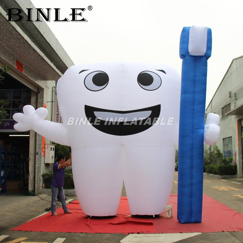 Advertising dental 4m 13ftH giant inflatable tooth with blue toothbrush inflatable tooth balloon cartoon model for sale image