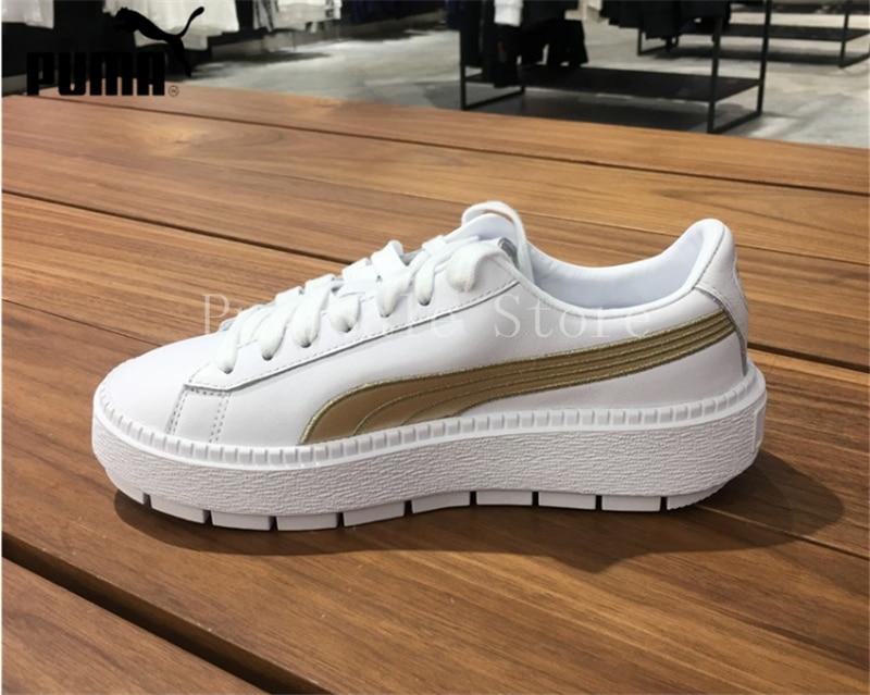 994ef7a4a38 ... PUMA Women s Platform Trace Sneaker Rihanna 4 Generation Thick Bottom  White Gold Shoes 367728-02 ...
