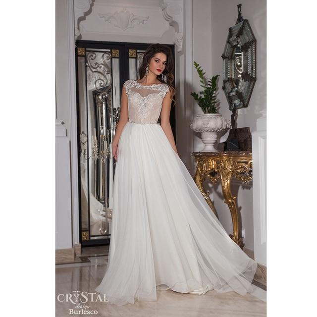 298bb86c7f3 Attractive Lace Wedding Dresses Cap Sleeve Appliqued Illusion Neckline A  line Bridal Dresses Floor Length Backless Wedding Dress