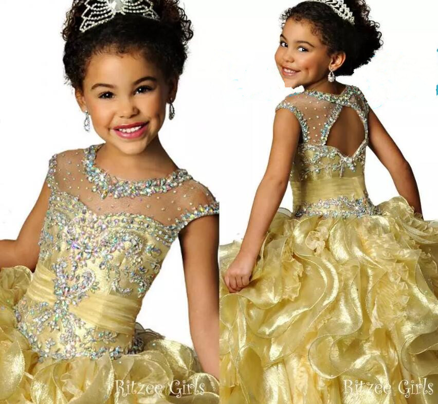 Luxury Crystals Gold Girls Pageant Dresses Illusion Neck Cap Sleeves Crystal Organza Glitz Ritzee Girls Pageant Gown