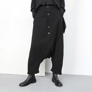 Image 5 - [EAM] جديد ربيع خريف 2020 عالي المرونة الخصر الأسود زر انقسام مشترك واسعة الساق السراويل الطويلة فضفاضة النساء بنطلون موضة YG2