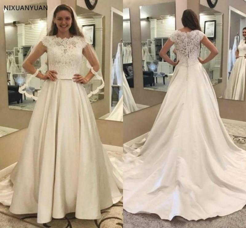 Us 8832 36 Offmodest Lace Satin Wedding Dresses A Line Cap Sleeves Garden Bridal Gowns With Pockets Court Train Plus Size Vestido De Novia In