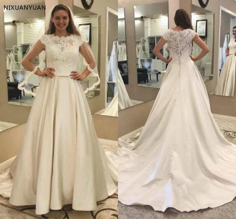 Robes De mariée en Satin dentelle modeste a-ligne Cap manches robes De mariée De jardin avec poches Court Train grande taille Vestido De Novia