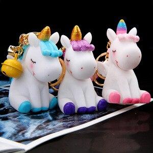Image 2 - Unicorn karikatür sevimli anahtar toka yumuşak Hairball hayvan bebek çanta süsler kız en iyi hediyeler küçük çan benzersiz ucuz sevimli oyuncak