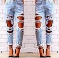 2016 nueva moda rasgado Jeans Femme ocasionales flojos agujeros lavados Boyfriend Jeans para mujeres Regular largos Torn Jeans salvaje pantalones de mezclilla