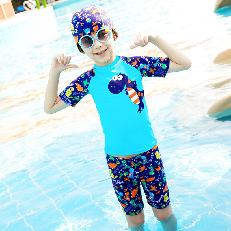 7a20be8bee847 Children swimwear Baby dinosaur printing two piece swimsuit Knee length boys  swim trunks with shirts   cap Dinosaur swimsuit-in Body Suits from Sports  ...