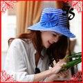 Venta al por mayor corea del estilo de señora Summer UV protective sun sombrero mujeres ala ancha de la raya sun beach sombrero con la flor envío gratis