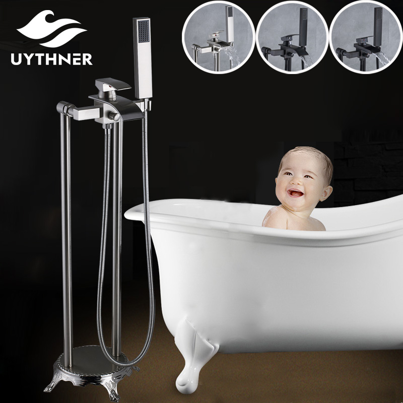 Uthyner Solid Brass Bathroom Tub Faucet Single Handle Waterfall Bathtub Mixer Tap with Hand Shower Floor Mounted free shipping polished chrome finish new wall mounted waterfall bathroom bathtub handheld shower tap mixer faucet yt 5333