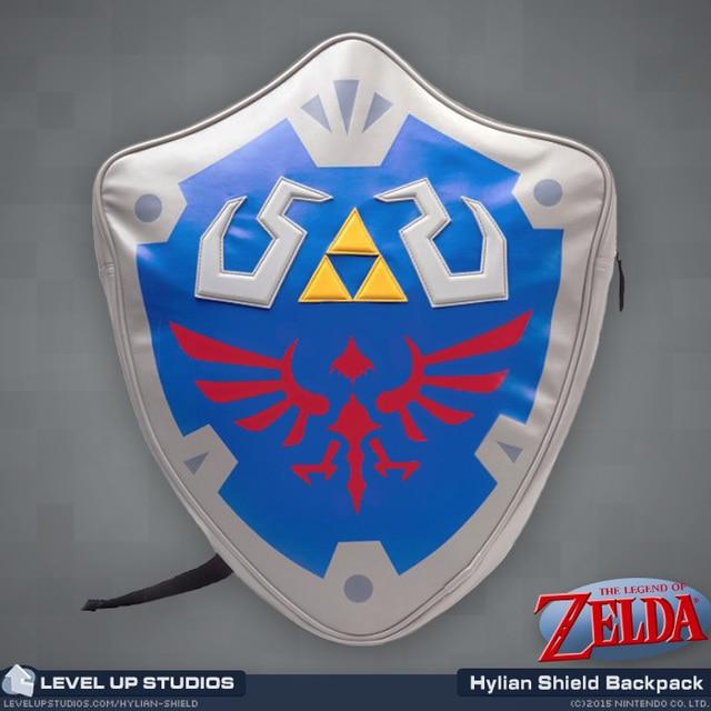 223379723d92 legend of zelda shield backpack   NEW   Official Legend Of Zelda Hylian  Shield Backpack 3D shield Shaped Backpack School Bag