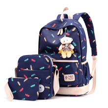 The new backpack shoulder portable three-piece canvas bag travel Korean fashion burden student bags