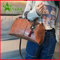 Casual wooden fringed women's handbag. Simple oil wax leather pillow bag. Single shoulder bag. Skew spanning.bag for women