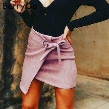 69d27a909a93fc BerryGo Hoge taille split suede mini rok Asymmetrische sash bow vrouwen rok  sexy rokken 2018 Herfst winter zwarte korte rok