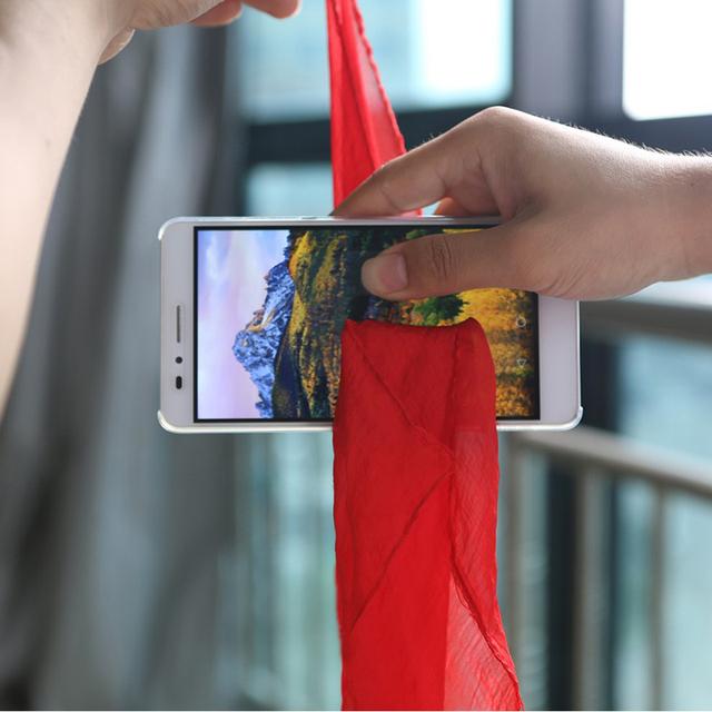 Professional Magic Trick Silk Through Phone Close Up