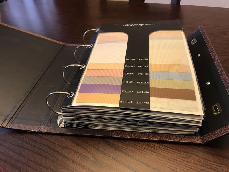Livro de amostras das cortinas do rolo da zebra