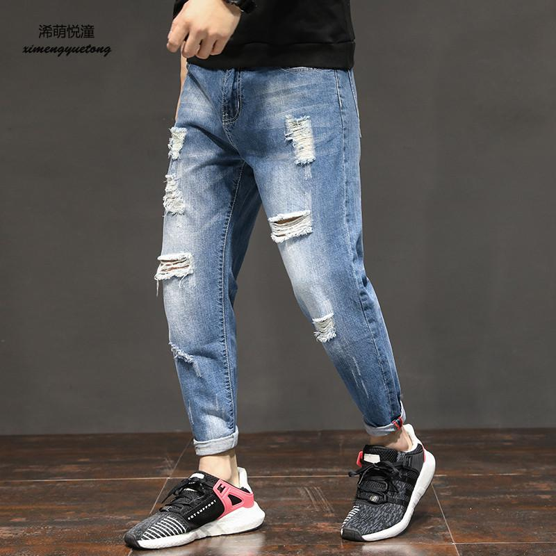 2018 spring and autumn new European and American trend wash water hole jeans mens street low waist wild feet jeans men