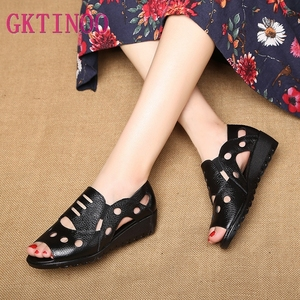 Image 1 - GKTINOO Rome Style Sexy Peep Toe Gladiator Sandals Women Flat Genuine Cow Leather Soft Sole Non Slip Hollow Summer Shoes Woman