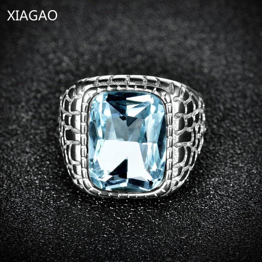XIAGAO नई आगमन ब्लू स्क्वायर पुरुष आभूषण 316L स्टेनलेस स्टील की अंगूठी काले लाल 3 ए जिक्रोन क्रिस्टा फैशन स्टील पुरुषों के छल्ले के साथ