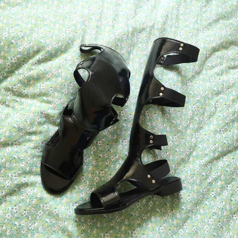 Thiết Kế Cổ Điển Thời Trang Võ Sĩ Giác Đấu Mùa Hè Giày Sandal Nữ Đầu Gối Cao Giày Nữ Gợi Cảm Các Đường Cắt Đen Giày Da Đầm Giày người Phụ Nữ