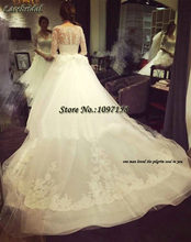 Luxury Elegant Ball Gown Cathedral Train Lace Beaded Wedding Dresses 2016 Sleeves V Neck Bow Ivory Long Church Bridal Gown XW140