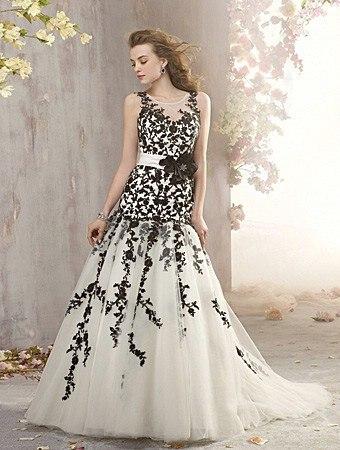Vestido negro con cinturon de flores