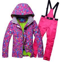 цены 2019 RIVIYELE Waterproof Sportwear Female Ski Suit Women Winter Ski wear Top Hoodie Jacket Strap Pants snow jacket and pants