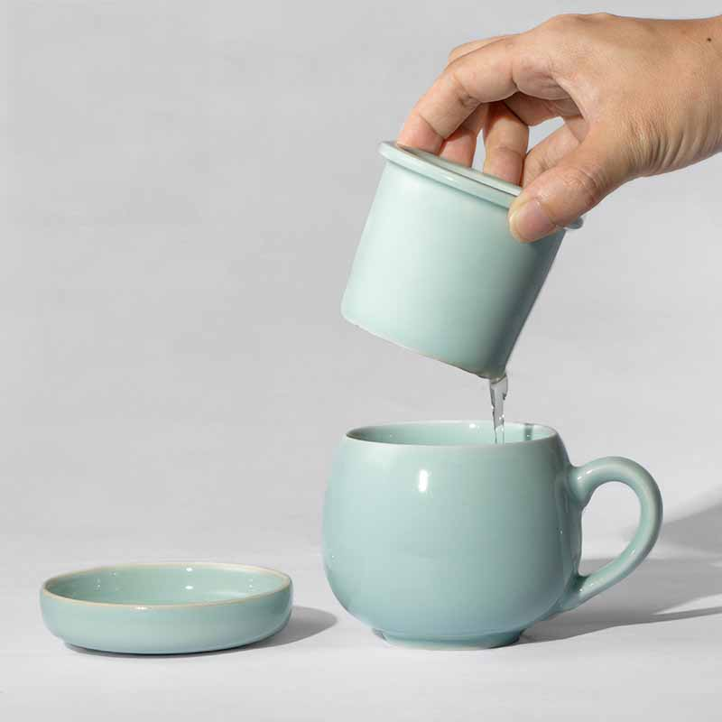 Ceramic teacup with strainer with lid Bubble tea cup isolated Concentric cup gift lid