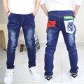 2016 Nuevos Niños Del Resorte del Niño Patchwork de Cuero Pantalones de Mezclilla Pantalones de Cintura Elástica Recta Fille Toddler Boys Jeans Jongens