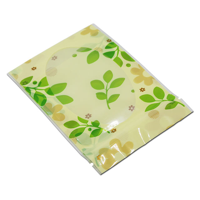 100PCS/ Lot Stand Up Heat Sealed Top Zipper Pack Bag Green Leaf Candy Storage Doypack Zip Lock Storage Pouches With Clear Window