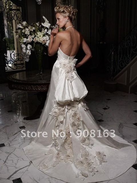 Wedding Dress Designer ! Duchesse Silk gown with silk rose accents. Neckline  is strapless with a soft sweetheart 315b8917635e