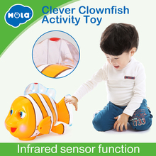Купить с кэшбэком HOLA 998 Baby Toys Infrared Sensor Clever Clown Fish with Music & Lights Electric Toys for Children 18 months+