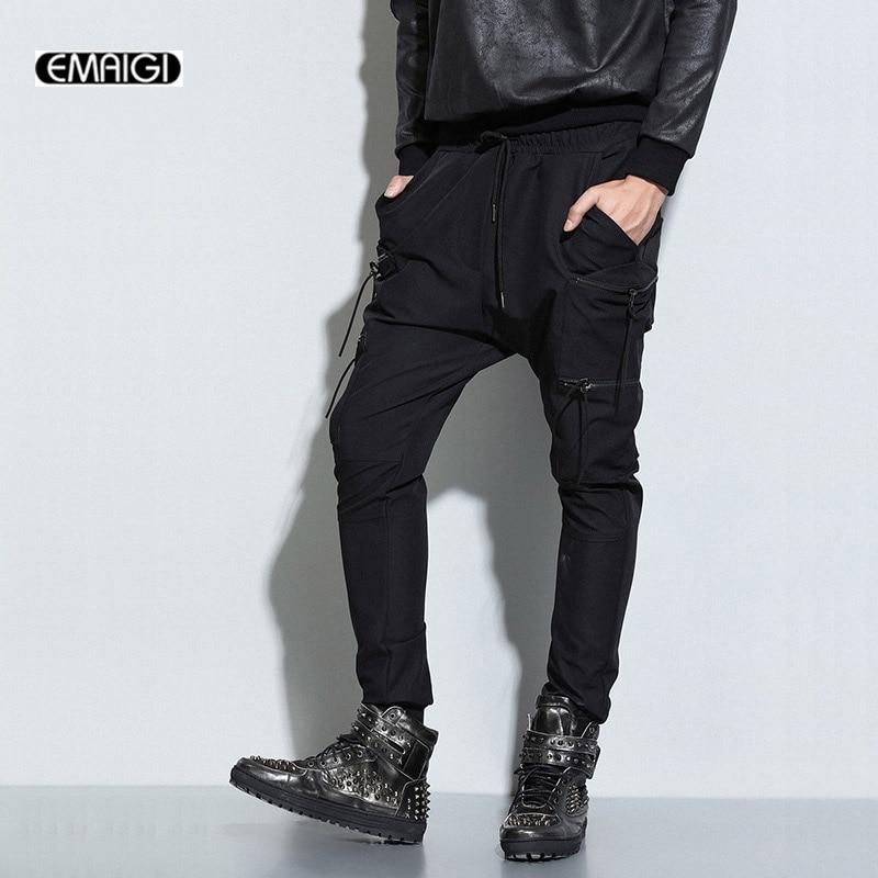 Мужчины повседневные брюки упругие талии шаровары высокое качество уличная мода мужчины черный хип-хоп панк брюки мужская молнии карманы брюки