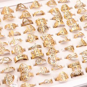 Image 2 - 50Pcs/lot Mix Random Style Laser Cut Pattern Golden Color Stainless Steel Rings Women Party Ring