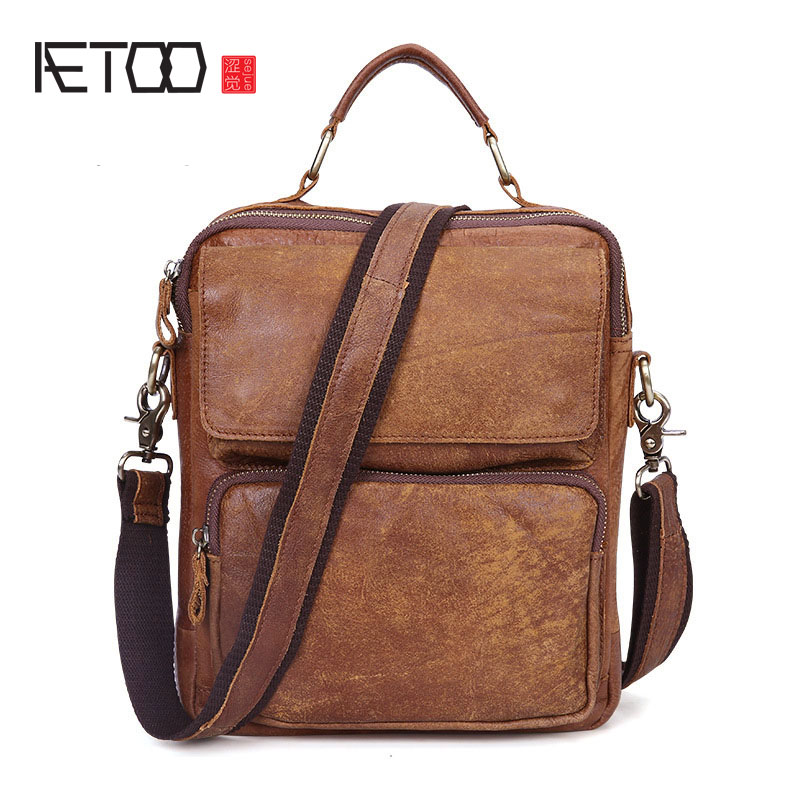AETOO New Europe and the United States fashion leather men bag retro first layer of leather men shoulder Messenger bag europe and the united states simple geometric pattern hand bag head layer of leather in the long wallet multi card large capacit