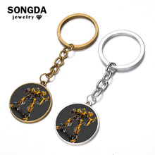 SONGDA 2018 Children Favorite Robot Transformation Series Key Chain Bumblebee Robot Art Picture Glass Dome Key Ring Bag Pendant(China)