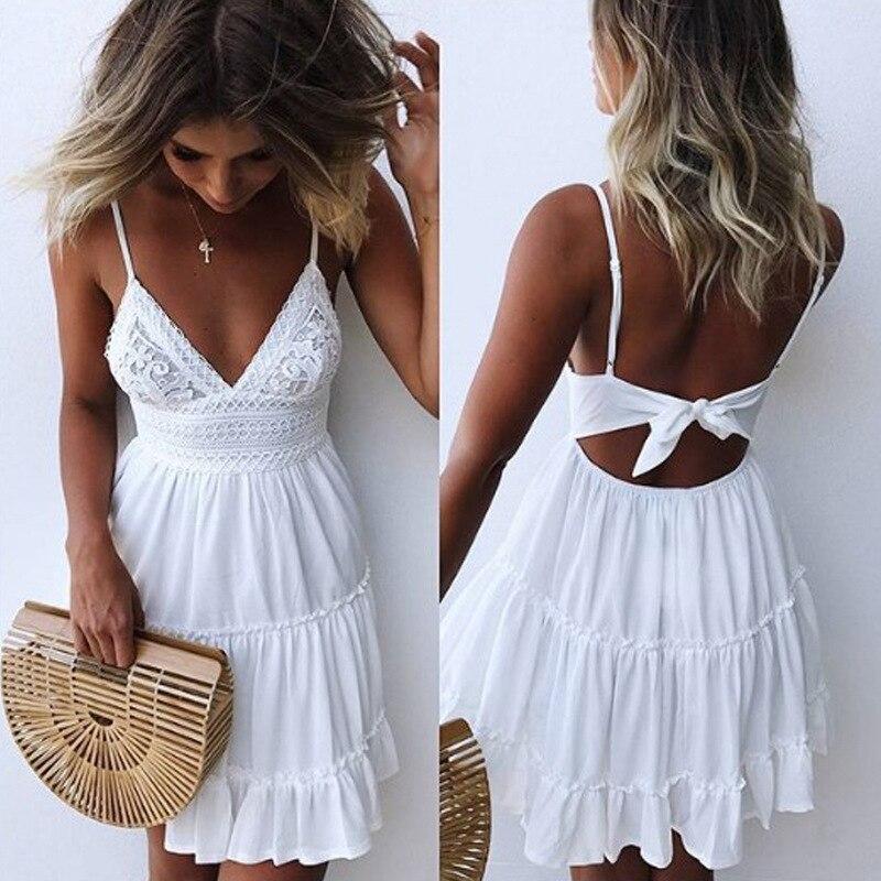 Verano mujeres encaje vestido Sexy espalda descubierta cuello en V playa vestidos 2018 moda sin mangas espagueti Correa blanca Casual Mini vestido de sol