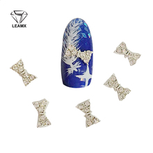 10 Pcs/bag Nail Alloy Jewelry Silver New Bow Paste The Crystal Manufacturers supply 3D Art Decoration Tools StickersH2